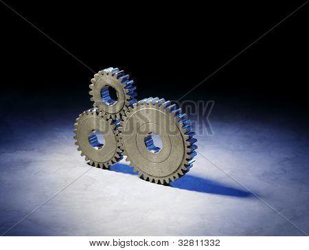 Still life with three old metallic cog gear wheels.