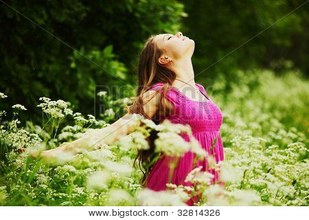 woman on green grass field feel freedom