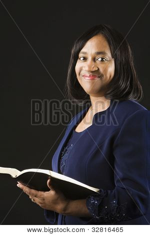 African woman holding open bible