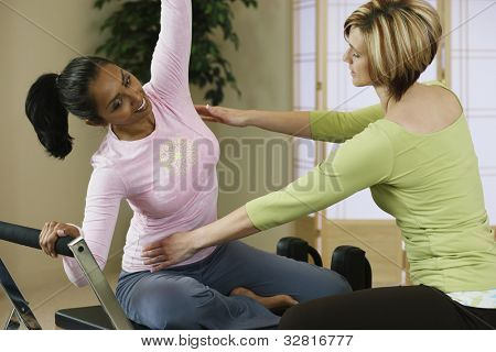 Indian woman exercising with personal trainer