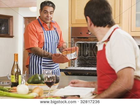 Two middle-aged men cooking
