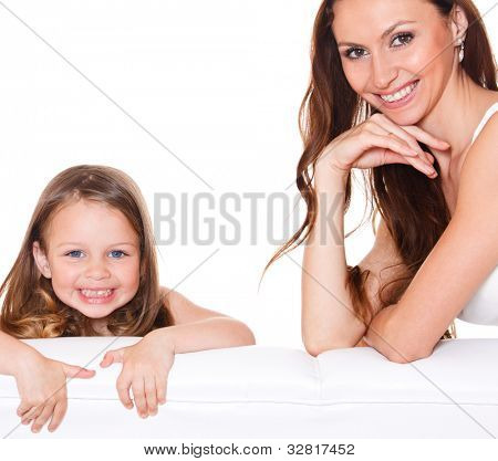 Beautiful mother and sweet daughter over white