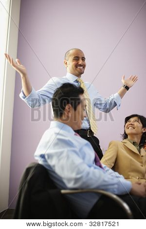 Multi-ethnic businesspeople in meeting