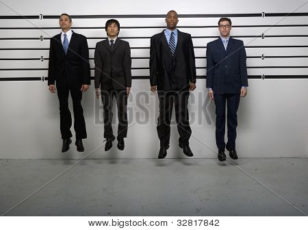 Multi-ethnic businessmen jumping in police line up