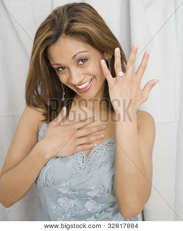 Indian woman showing off engagement ring