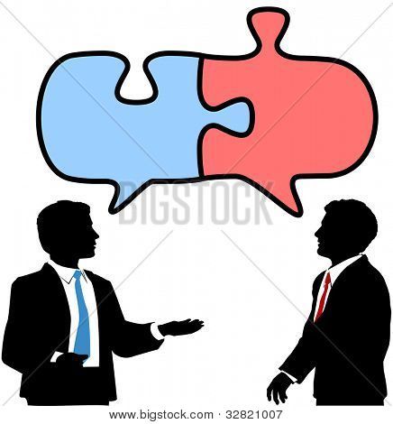 Two business people talk to find solution in puzzle shape speech bubbles
