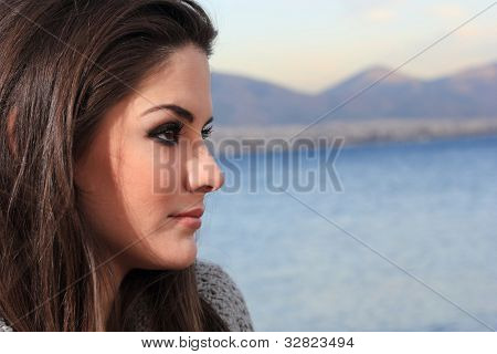 Happy young woman bu the sea in Greece