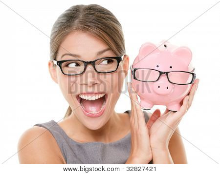 Save money on glasses eyewear. Woman happy and excited over savings on buying eyewear glasses. Piggybank and woman wearing glasses isolated on white background.