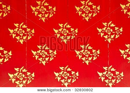 Flower Pattern In Traditional Thai Style Art On Wall Of The Temple