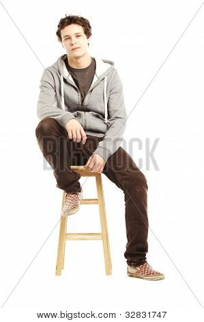 Young Handsome Man With Hip Style Sitting