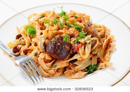 An aubergine (eggplant) and tomato sauce served tossed with fettuccelle pasta and garnished with fresh parsley