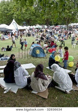 Festival Goers At The Exeter Respect Festival Sit In The Park And Enjoy The Day