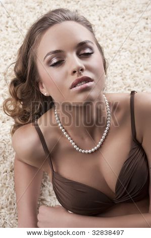 Young Alluring Brunette In Bra Over Carpet