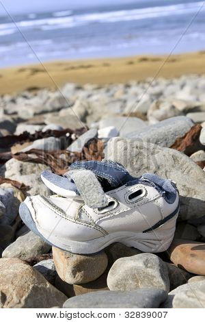 Abandoned Running Shoe On A Rocky Irish Beach
