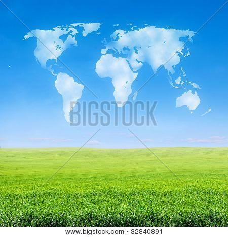 Field Of Grass With World Shaped Clouds