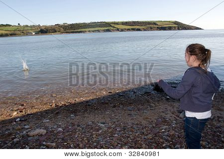 Young Girl Throwing A Stone