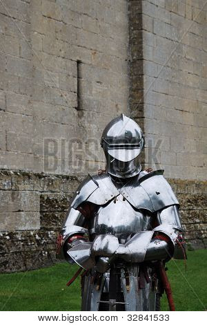 Knight in armour in front of castle