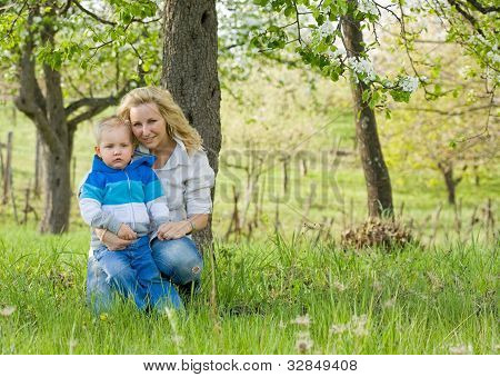 Attractive Mom And Her Son Outdoors.