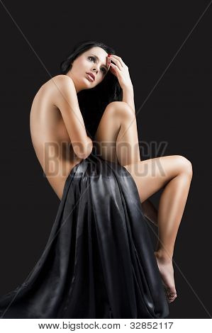 The Nude Cute Sexy Woman Over Black, She Looks Up