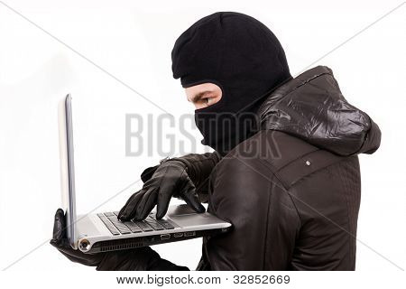 Hacker stealing data from laptop computer, isolated on white