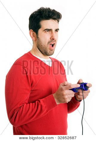 young man focused on playing video games, isolated on white