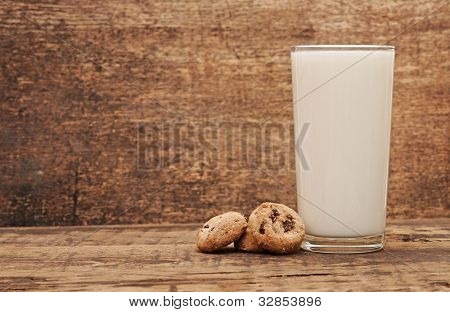 delicious chocolate cookies staked around glass of fresh milk