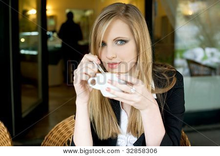 Elegant Young Blond Woman On Cofffee Break.
