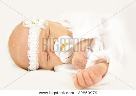 Adorable new born baby with head band on white
