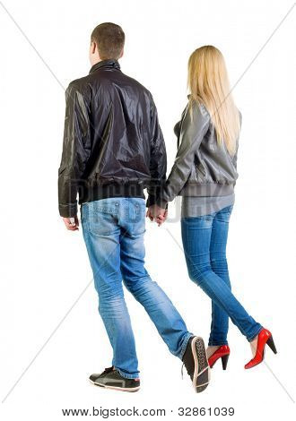 going young couple (man and woman) Back view. walking friendly girl and guy in jacket and jeans together. Rear view people collection.  backside view of person.  Isolated over white background