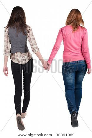 Back view going of two young girl (brunette and blonde)  . Rear view people collection.  backside view of person. beautiful woman friends  walking. Rear view. Isolated over white background.