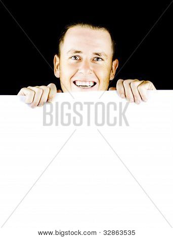 Smiling Young Man Holding Blank Poster