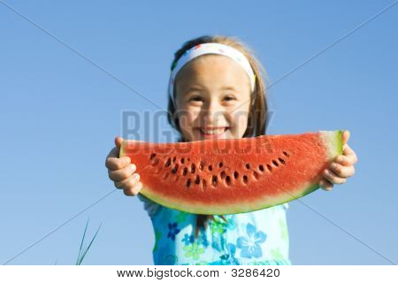 Girl Showing A Watermelon Slice