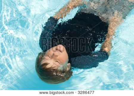 Boy Swimming In Pool