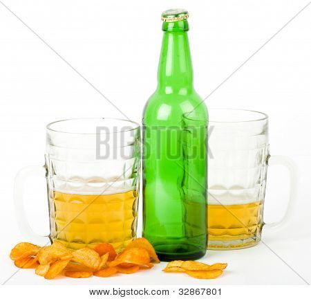 Beer green bottle and potato chips, isolated on white