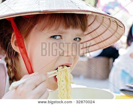 Little Girl Eating Korean Style Spaghetti (ramen)