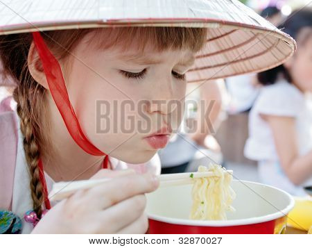 Young Girl Eating Korean-style Spaghetti In Restaurant