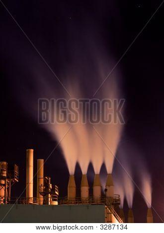Smokestacks At Night