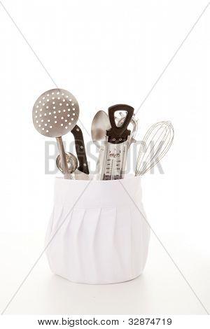 kitchen cooking equipment, chefs hat with utensils.