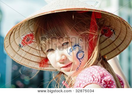 Portrait Of A Little Girl With Blue Dragon On Her Cheek
