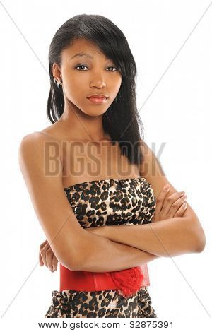 portrait of beautiful African American teenager with arms crossed isolated over white background