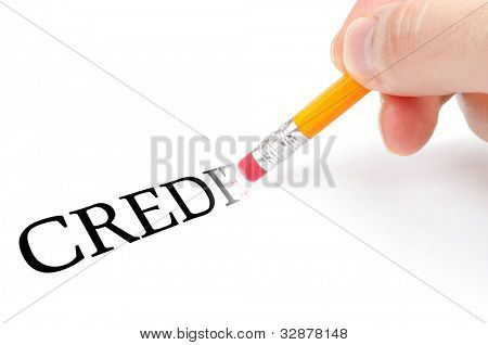 "Male hand holding wooden pencil with eraser and erase word ""credit"""