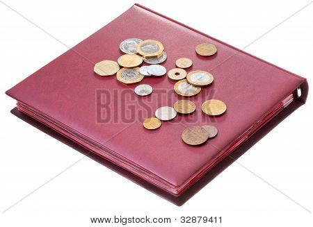Different Coins On Red Numismatics Album