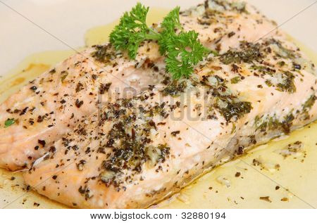 Salmon fillets baked with herbs and olive oil.