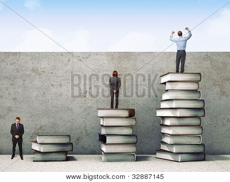 business people on books pile 3d
