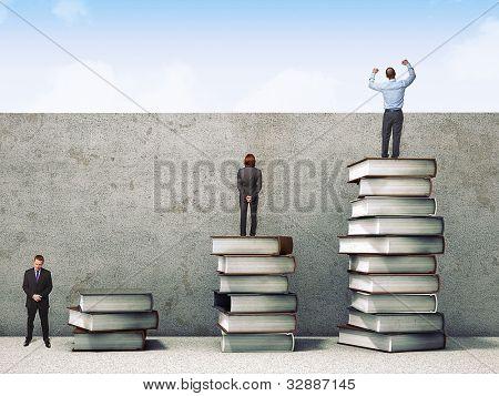 Geschäftsleute auf Bücher 3d Stapeln