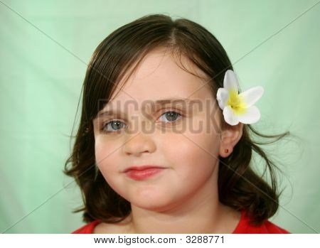 Little Girl With Flower In Her Hair
