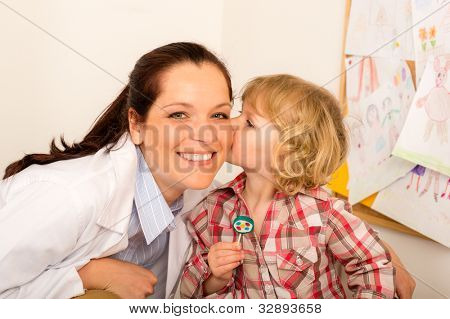 Thank you doctor - Little girl kissing female pediatrician