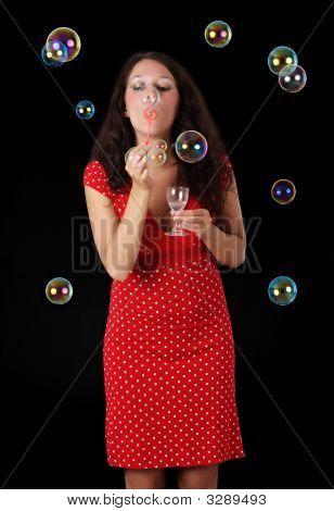 Woman Blowing Soap Bubble