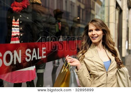 Sale: Young and happy woman shopping