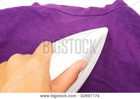 hand ironing violet clothes